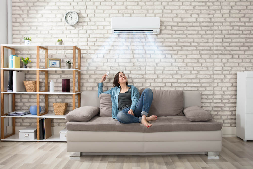 Ductless Mini-Split women on couch with air conditioning