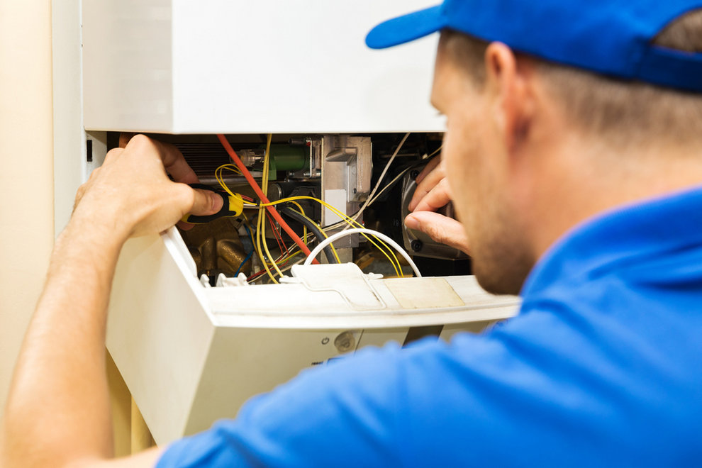 Technician Doing Heating Repair in San Diego