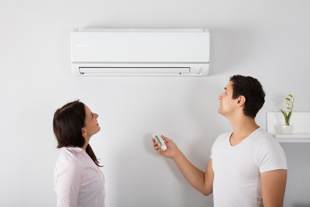 Couple turning off AC (4 Air Conditioning Myths That are Costing You Money)